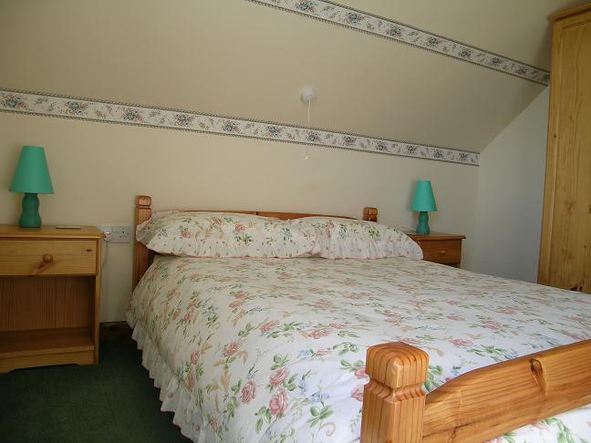 Gwyddfid cottage masterbedroom, 3 bedroom self catering cottage.